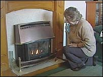 Pensioner in front of fire