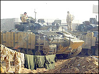 Soldiers on tanks at Camp Dogwood