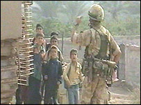 Soldier turning back Iraqi schoolchildren