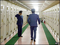 Prison keepers checks cells in the Fuchu prison in Tokyo 27 May 2003.
