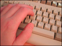 A hand on a keyboard