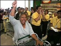 A happy shopper enters the new Wal-Mart store