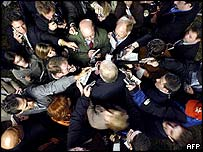 Reporters surround Karl Rove