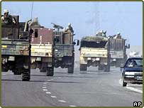 American soldiers convoy towards the insurgent-held city of Falluja, as Falluja residents evacuate the Iraqi city, Friday 5 November 2004