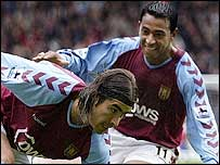 Aston Villa goalscorers Juan Pablo Angel (left) and Nolberto Solano celebrate