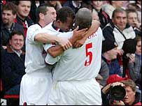 Rob Earnshaw celebrates with his team-mates at St Mary's