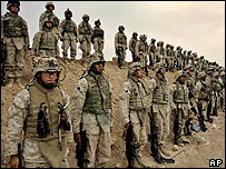 US Marines of the 1st Division line up for a joined prayer at their base outside Falluja, Iraq
