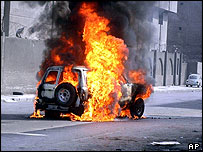 Iraqi police vehicle on fire in Baghdad after rocket-propelled grenade attack, 7 November 2004