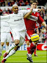 Bolton winger El Hadji Diouf and Boro defender Chris Riggott tussle for possession