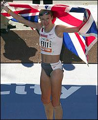 Paula Radcliffe celebrates with the Union Jack flag