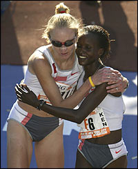 Radcliffe hugs fellow competitor Susan Chepkemei