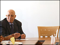 Ahmed Qurei next to the empty chair where Yasser Arafat used to sit, at a meeting of the Palestinian National Security Council