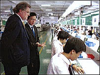 Mr Jones visits a Chinese factory in October 2004