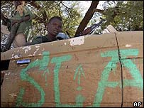 Rebels of the Sudanese Libration Army watch for Janjaweed in southern Darfur