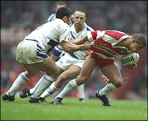 Wigan's Jason Robinson is held back by Tea Ropati of St Helens during the 1993 Premiership final
