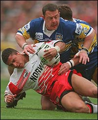 Robinson is tackled by Gary Schofield of Leeds during the 1995 Challenge Cup final at Wembley