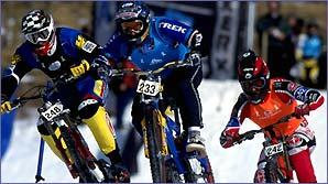 Steve Peat (left, 248) competes in a harem-scarem four cross race