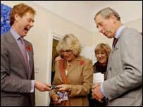 The Prince of Wales shares a joke with Mrs Camilla Parker-Bowles and Dr Tim Robinson