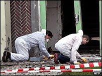 Forensics officers inspect bomb damage at Eindhoven Muslim school