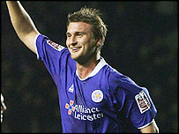 Defender Matt Heath celebrates after scoring Leicester's third of the match