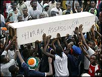 Demonstrators outside Hotel Ivoire on Tuesday