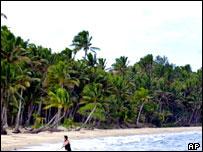 A tourist on a beach near Suva