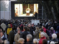 Mourners watch Van Gogh cremation ceremony