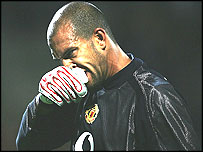 Tim Howard looks dejected after conceding a goal against Lyon
