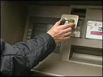 A card skimming device being attached to a cash machine