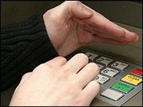 A person entering a PIN number