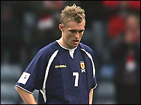 Darren Fletcher suffers while playing for Scotland