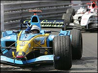 Jarno Trulli's Renault is followed by Jenson Button's BAR on the slowing down lap in Monaco