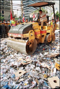 A steamroller crushes pirated goods in Thailand