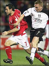 Andy Reid (left) tries to get away from Fulham's Mark Pembridge