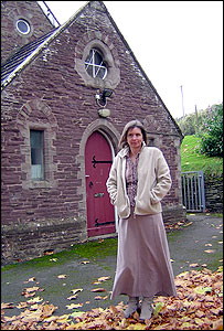 Gail Richards outside the school
