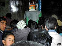 Afghan people watch a movie in Kabul