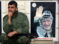 Palestinian security man cries on hearing of Yasser Arafat's death in Gaza City