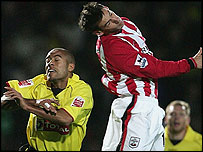 James Chambers of Watford gets tackled by Rory Delap
