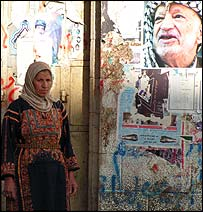 Palestinian woman watching mourners at Manara junction