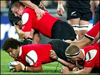 Colin Charvis scores against New Zealand at the 2003 World Cup