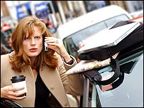 Woman with mobile phone, coffee and computer