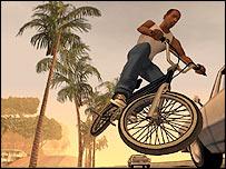 CJ pulling bike tricks