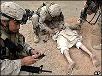 US marines of the fifth division arrest an Iraqi man in the centre of Falluja