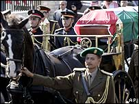 Yasser Arafat's coffin is carried on a horse-drawn carriage, Cairo, 12 November 2004