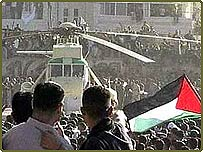 The helicopter with Yasser Arafat's coffin lands in Ramallah