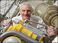 Sir James Dyson and his cylinder model vacuum