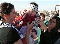 A Palestinian mother and baby at Yasser Arafat's burial.
