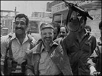 Yasser Arafat with followers in Beirut in 1982