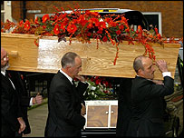 John Peel's coffin is carried into the church
