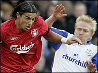 Liverpool's Milan Baros is challenged by Aki Riihilahti